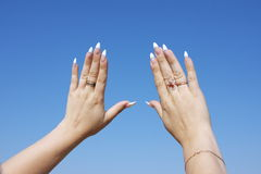 Woman hand with a manicure on a backgrou Royalty Free Stock Photography
