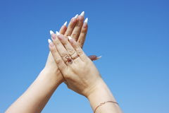Woman hand with a manicure on a backgrou Royalty Free Stock Images