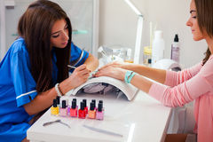Woman hand on manicure treatment in beauty salon. Beauty parlour. Indoor photo stock photos