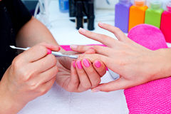 Woman hand on manicure Stock Photos