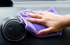 Woman hand with microfiber cloth polishing Royalty Free Stock Photos
