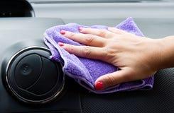 Woman hand with microfiber cloth polishing Royalty Free Stock Photos