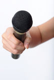 Woman hand with microphone Stock Images