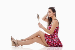 Woman with hand mirror Royalty Free Stock Photo
