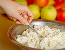 Woman hand  with mixing curds  in the  cup Royalty Free Stock Images