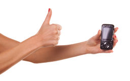 Woman hand and mobile phone. Stock Photo