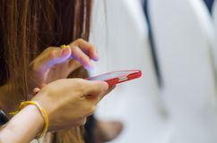 Woman hand and mobile smart phone Royalty Free Stock Images