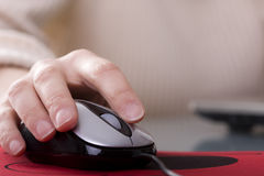 Woman hand on a mouse Royalty Free Stock Photos