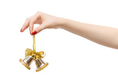 Woman hand with new year bell Stock Photo