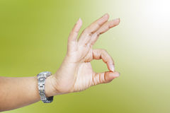 Woman hand in ok sign. Blur background Royalty Free Stock Photography