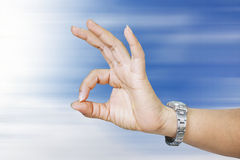Woman hand in ok sign. Blur background Stock Photos