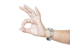 Woman hand in ok sign. On a white isolated background Stock Photo