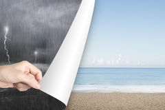 Woman hand open calm beach page replace stormy ocean Royalty Free Stock Image