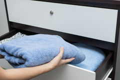 Woman hand open drawer   Stock Photography