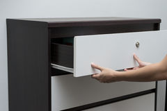 Woman hand open drawer   Stock Photos