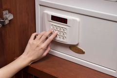 Woman hand opened a safe, close up Royalty Free Stock Image