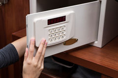 Woman hand opened a safe, close up , open Stock Photos
