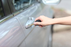 Woman hand opening car door, close up Royalty Free Stock Images