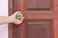 Woman hand opening the door Stock Photography