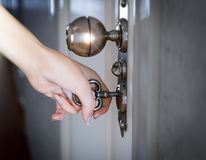 Woman hand opening the door conceptual background Stock Photos