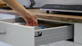 Woman Hand Opening Drawers Of A White Kitchen Cupboard.  stock video