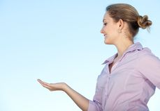 Woman with hand outstretched Stock Photography