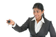 Woman hand over car key to client. Indian car dealer hand over vehicle key to client,  on white background Stock Images