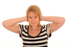 Woman with hand over her ears Stock Photography