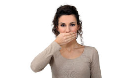 Woman with hand over mouth Royalty Free Stock Photos