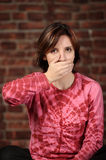 Woman with hand over mouth Royalty Free Stock Image