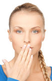 Woman with hand over mouth Royalty Free Stock Images