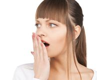 Woman with hand over mouth Stock Photography