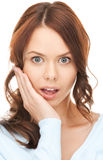 Woman with hand over mouth Royalty Free Stock Photo
