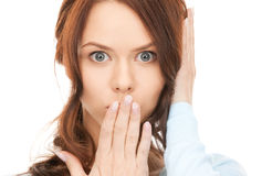 Woman with hand over mouth Stock Image