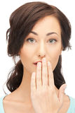 Woman with hand over mouth Royalty Free Stock Photography