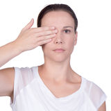 Woman with hand over one eye Stock Photos