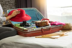 Woman hand packing a luggage for a new journey and travel for a. Long weekend stock photo