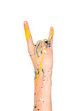 Woman hand in paint making  sign of the horns (rockers) Stock Photos