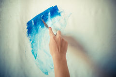 Woman hand painting Stock Photos