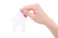 Woman hand with paper house isolated on white Royalty Free Stock Photography
