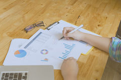 Woman hand, pen, glasses, business document, laptop computer not Stock Photo