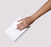 Woman hand with pen and notebook. On a white background Stock Images