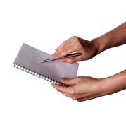 Woman hand with pen and notebook. On a white background Royalty Free Stock Photography