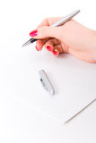 Woman hand with pen and paper Royalty Free Stock Image