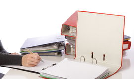 Woman hand pen - Pile of folders Stock Photography