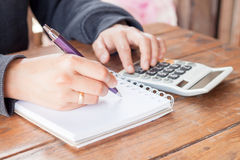 Woman hand with pen writing on notebook Stock Photos