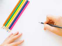 Woman hand with pencil writing Stock Photo