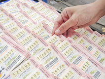 Woman hand picking Thai lottery Royalty Free Stock Photography