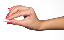 Woman hand with pill. Woman hand holding the pill Royalty Free Stock Image