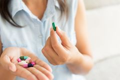 Woman hand with pills medicine tablets and capsule in her hands. Healthcare, medical supplements concept royalty free stock photos